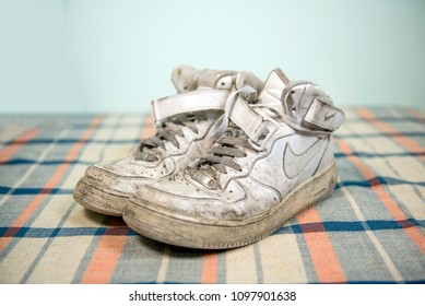 Pavia, Italy - August 17, 2016: Old and dirty pair of Nike Air Force One shoes - illustrative editorial