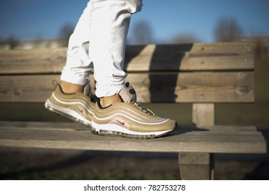 Pavia, Italy - December 13, 2017: Nike Air Max 97 Gold shoes in the street