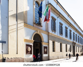 PAVIA, ITALY - FEBRUARY 22, 2019: studens near Central building University of Pavia (UNIPV, Universita degli Studi di Pavia, Alma Ticinensis Universitas) on street Corso Strada Nuova in Pavia city