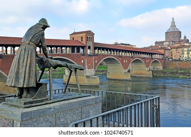 "Pavia, Italy. february14,2018. The Ponte Coperto (""covered bridge"") or the Ponte Vecchio (""Old Bridge"") is a brick and stone arch bridge over the Ticino River in Pavia, Italy. Duomo di Pavia visible"