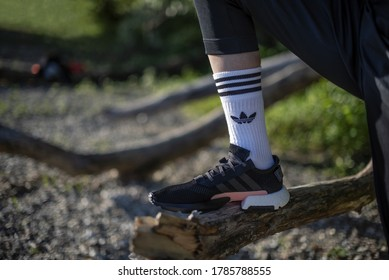 Pavia, Italy - May 21, 2019: Young man wearing Adidas POD-S3.1 shoes and Adidas white socks outside - illustrative editorial