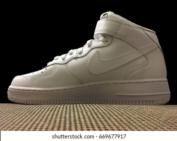 Pavia, Italy - Novembre 24, 2016: White Nike Air Force One shoes - illustrative editorial