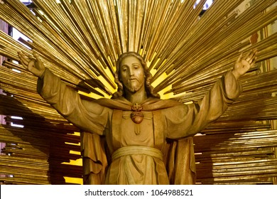 """Pavia, Italy. October 2 2017. The statue of the Most Holy Heart of Jesus with an open embrace in the """"Santa Maria del Carmine"""" church (Holy Mary of Carmel)"""