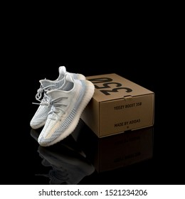 Pavia, Italy - October 3, 2019: Adidas Yeezy Boost 350 V2 Cloud White (Non-Reflective) shoes studio portrait - illustrative editorial