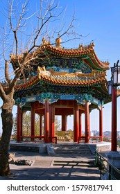 Pavilion of Gathering Fragrance in Jingshan Park. octagonal two-tiered pointed roof. traditional chinese architecture. Pavilion dedicated to Amitabha Buddha