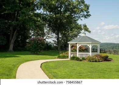 A pavilion or gazebo in a beautiful public garden park.