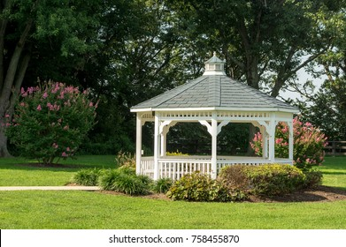 A pavilion or gazebo in a beautiful public garden park.