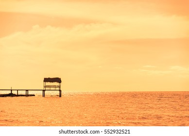 The pavilion in sea with sunset light