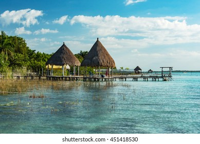 pavilion with thatched roof at laguna of bacalar