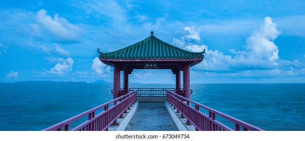 "A pavilion in traditional chinese style in blue hour (pavilion Chinese name is translated to ""Listen to Sea Pavilion"")"