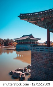 The pavilions of Anapji Pond reflected in the water in Gyeongju.The Gyeongju Historic Areas of South Korea were designated as a World Heritage Site by UNESCO in 2000, ref 976. Teal and orange view.