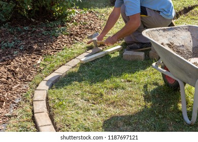 Paving lawn edge in the garden