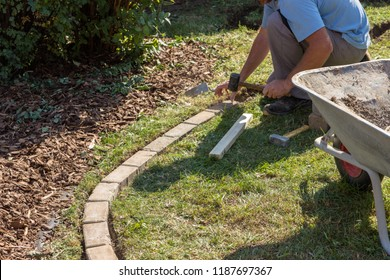 Paving lawn edge in the garden