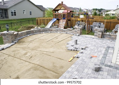 Paving patio on to leveled sand. Backyard Project.