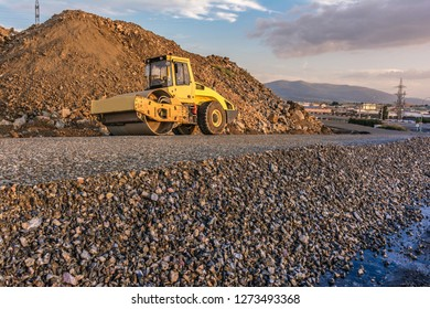 Paving road with a steamroller after making the first layer of asphalt