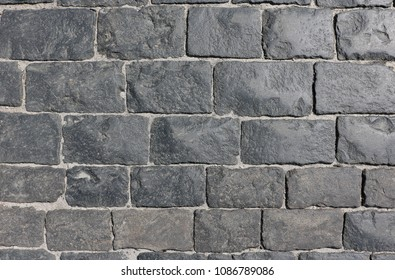 Paving stone on Red Square, cobbles on the Red Square,from gabbro-diabases from the islands of Onega Lake in Karelia, made of natural stone.Gabboro diabase is a hand-hewn stone of rare magmatic rocks.