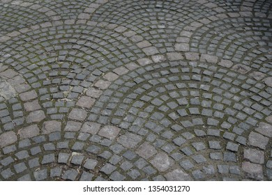 Paving stone texture, cobblestone road. Smooth, time-polished stone