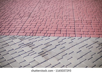 Paving stones. Concept of laying paving slabs and pavers. Paving stones. Concrete pavement blocks