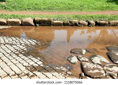 paving stones and slabs under a puddle on the via apia in Rome