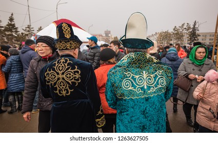 Pavlodar, Kazakhstan - March 22, 2018: Two aged Kazakh men dressed in colorful traditional caftans and hats with handmade ornaments, celebration of Nauryz (New Year) according to the Eastern Calendar,