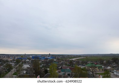 PAVLOGRAD, UKRAINE - April 17, 2017: View from afar to some part of the city in Pavlograd. Landscape with a lot of buildings and plantings, leaving in perspective to the horizon