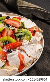 Pavlova cake with fresh blueberries, strawberries and kiwi.