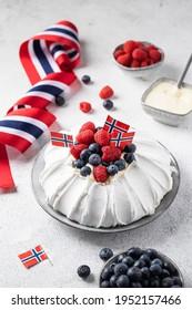 Pavlova cake with strawberries and blueberries and vanilla cream. Norwegian constitutional day. 17th May.