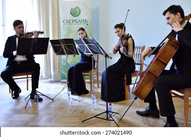 PAVLOVSK, ST. PETERSBURG, RUSSIA - APRIL 29, 2015: String quartet plays during the ceremony of the return of the marble vase stolen during the WWII to the State Museum-Reserve Pavlovsk