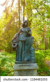 Pavlovsk, St Petersburg, Russia - September 21, 2017. Bronze sculpture of Melpomene - the muse of tragedy, with a tragic mask. Old Silvia park in Pavlovsk, Saint Petersburg, Russia