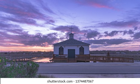 Pawleys Island, South Carolina / USA - April 19, 2019: A lone church sitting on the marsh at sunset in Pawleys Island, South Carolina.