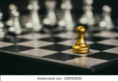 The Pawn in battle chess game stand on chessboard with black isolated background. Business leader concept for market target strategy. Intelligence challenge and business competition success play.