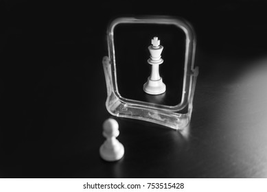 The pawn looks in the mirror and sees the king