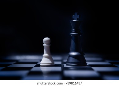 Pawn VS King in the Chess game. Confrontation of chess game in the final. The Power of Small Wins. Power of Management concept.