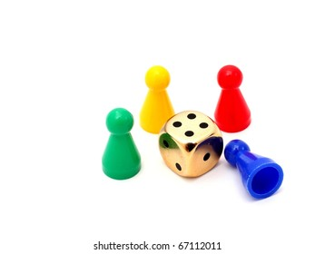 pawns in green, yellow, red and blue with a cube