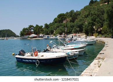 PAXOS, GREECE - JUNE 10, 2014: Boats moored in the harbour at Lakka on the Greek island of Paxos. The 13km long island has a population of around 2300.