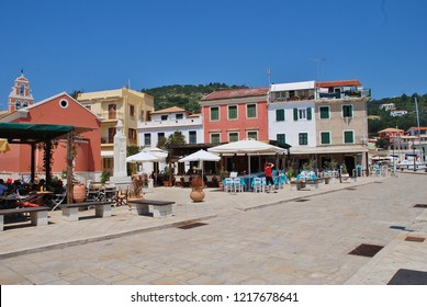 PAXOS, GREECE - JUNE 12, 2014: Harbour front tavernas at Gaios on the Greek island of Paxos. The town is the Capital of the island which has a population of around 2300.