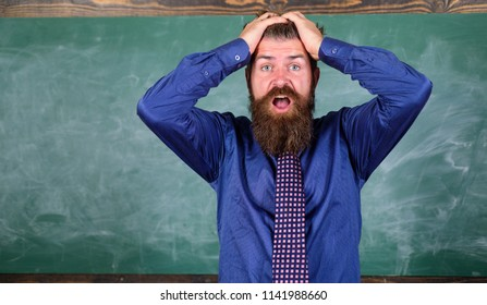Pay attention to your behaviour and manners. Teacher etiquette tips modern education professional. Teacher behaves unprofessionally. Man bearded teacher or educator hold head chalkboard background.