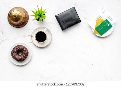 Pay the bill, pay at restaurant. Check near wallet, bank card, service bell, coffee on white background top view copy space