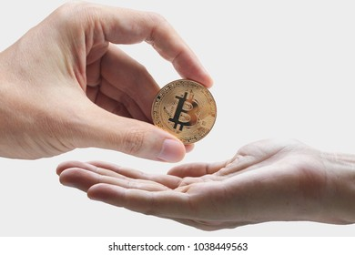 pay bitcoin, hand use bitcoin digital technology on a white background, currency blockchain technology concept