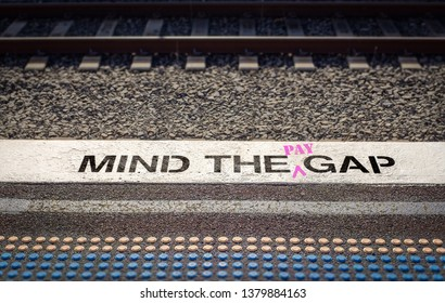 Pay gap, Mind the pay gap graffiti in pink, Gender pay equality concept – Image