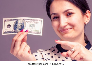 Pay Me, money is my best motivation. Close up business woman with US Dollar bill.