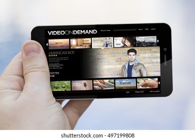 pay per view concept: hand holding an video on demand 3d generated smartphone. Screen graphics are made up.