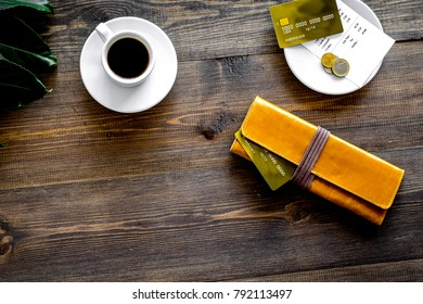 Pay in the restaurant. Purse, bill and bank card near cup of cof