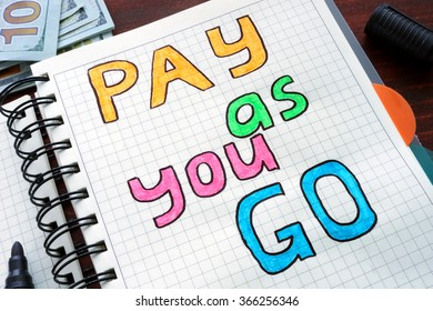 Pay as you go PAYG written on a notebook. Business concept.