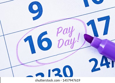 Payday concept. Business, finance, savings money, wages, payroll or accounting concept. Calendar with marker circle in word payday for remind.