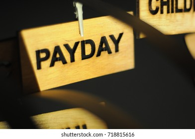 PAYDAY on a wooden sign, photograph Aspirations word
