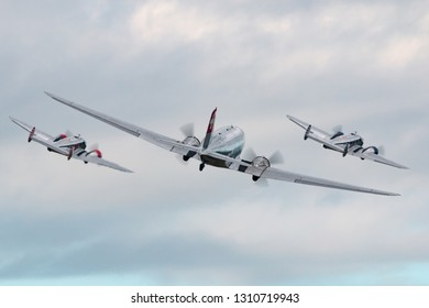 Payerne, Switzerland - August 30, 2014: Douglas DC-3C vintage airliner N431HM flying in formation with two beech 18 aircraft.