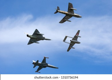 Payerne, Switzerland - August 30, 2014: Formation of former Swiss Air force jet aircraft comprised of a de Havilland Vampire, Hawker Hunter, Northrop F-5 and Dassault Mirage.