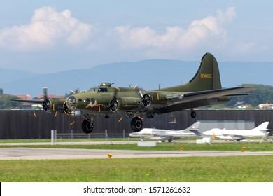 "Payerne, Switzerland - September 4, 2014: World War II era Boeing B-17 Flying Fortress bomber aircraft ""Sally B"" (G-BEDF)."