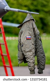 Payerne, Switzerland - September 5, 2014: Slovak Air Force pilot's jacket hanging off the nose of Mikoyan-Gurevich MiG-29UB aircraft.